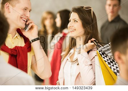 Man talking on the phone after having had shopping