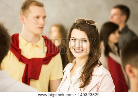 Woman standing in the crowd and smiling