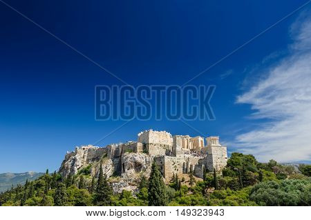 Ancient Acropolis during daytime. Athens Greece. Lot of copyspace.