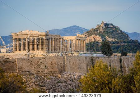 Ancient Acropolis in rays of sunset. Athens Greece