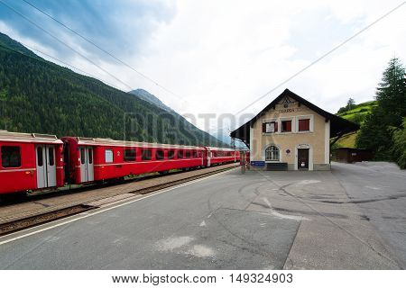 Station of the Swiss village of Guarda with little red train graubuenden