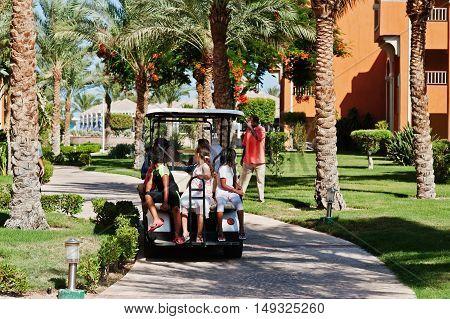 Hurghada, Egypt -20 August 2016: Arabian Children Sitting On Small Electric Golf Car In Resort