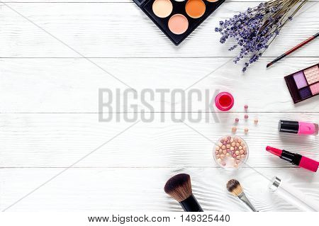 cosmetic set on white wooden table with lavender top view, mock-up