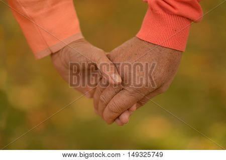 Couple of hands together on background close-up