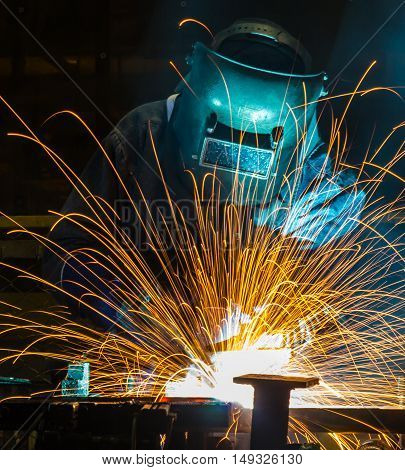 welding work in Industrial automotive part in car production factory.  with fire spark