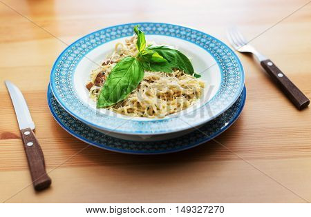 noodles decorated with herbs served on a wooden table