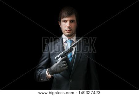 Hitman Or Murderer With Pistol With Silencer On Black Background