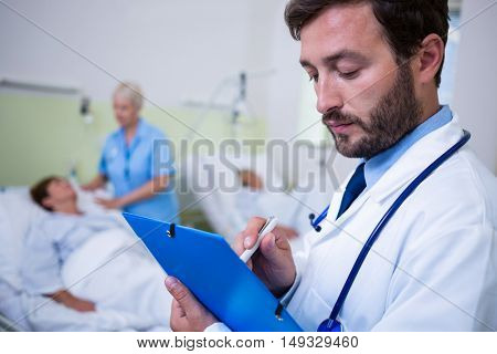 Doctor checking a medical report in hospital room
