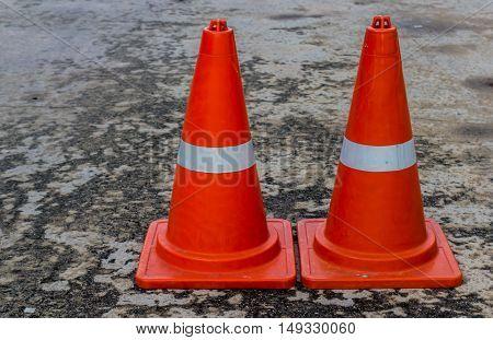 Traffic cone Orange on the floor cement road