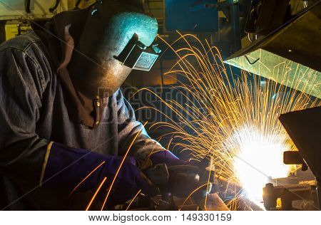 Skill welder worker in Industrial automotive part in car production factory