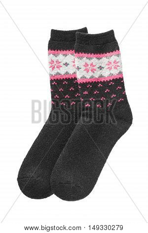 Black knitted wool socks on white background