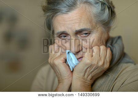 Portrait of a sick senior woman close up