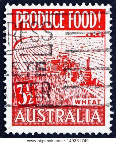 AUSTRALIA - CIRCA 1953: a stamp printed in Australia shows Wheat Harvest Food Production circa 1953