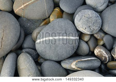 Rounded pebbles at the tropical beach