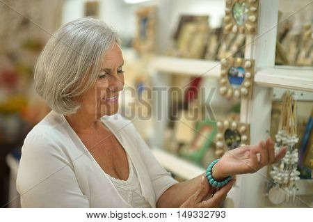 Beautiful senior woman in a shopping center