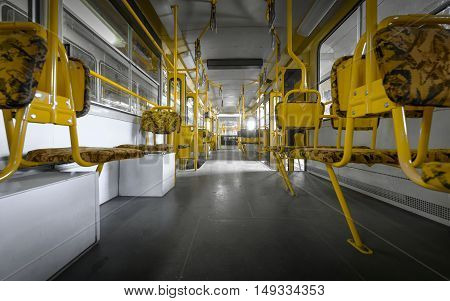 Angle shot of tram interior with yellow seats