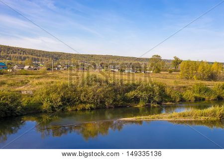 Legostaeva village on the Bank of the Berd river Novosibirsk oblast Siberia Russia - September 11 2016: rural autumn landscape with river