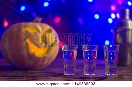 cocktail for halloween party on the scary pumpkin backstage, selective focus.