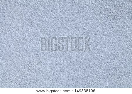 Light blue leather texture background with pattern closeup.