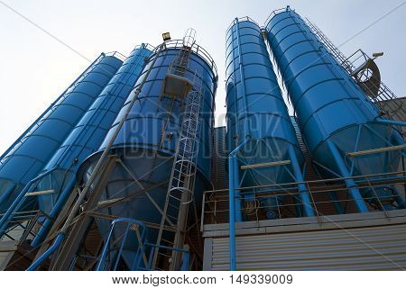 Bottom perspective of storage Tower Silos blue