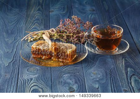 Honeycomb, Glass Pot With Honey And Oregano On Color Wooden Background