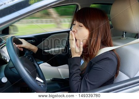 Closeup portrait sleepy tired close eyes young woman driving her car after long hour trip Sleep deprivation accident concept