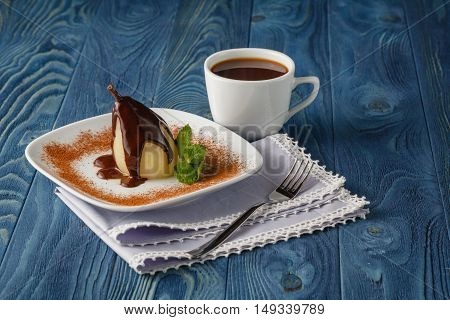poached pear with chocolate and coffee cup