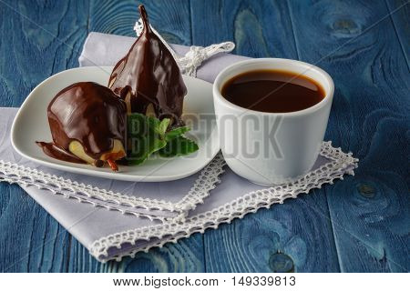 Dessert of pears with chocolate syrup with coffee