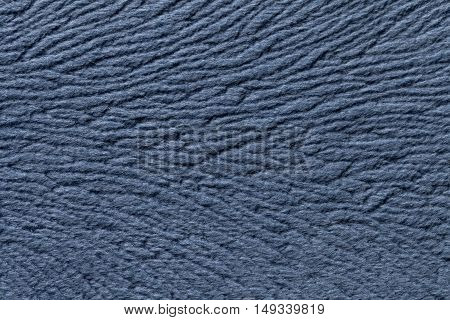 Light blue background from a soft wool textile material closeup. Fabric with natural texture. Cloth backdrop.