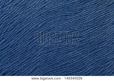 Navy blue background from a soft wool textile material closeup. Fabric with natural texture. Cloth backdrop.
