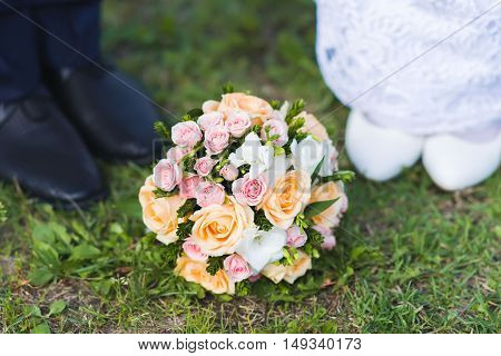 Wedding bouquet on the ground. Other flowers