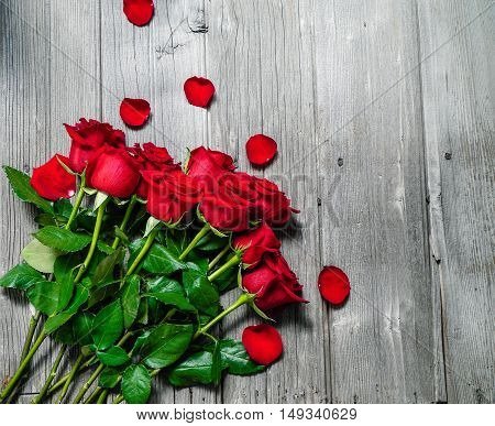 Dozen Red Roses on Wood Background / Proposal/ top view