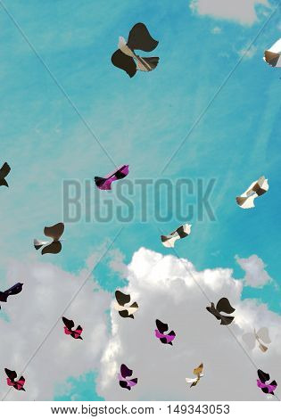 Street decorated with colored paper bird against sky. Summer celebration.