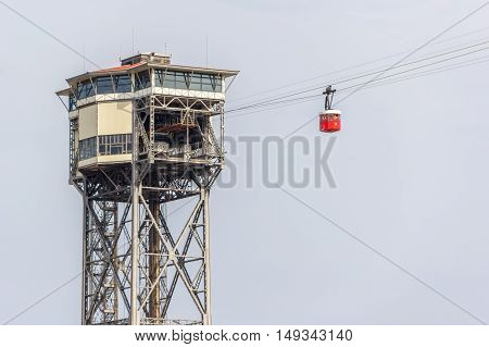 Barcelona Spain - August 17 2016: Cableway in the port of Barcelona. Red cabin goes to parking