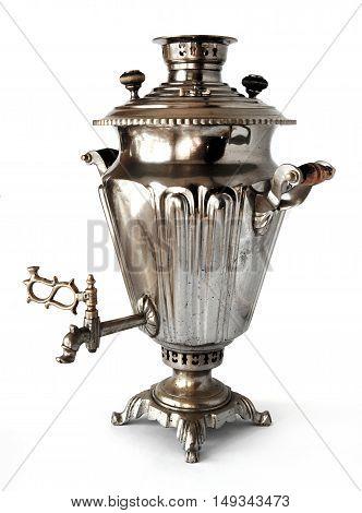 Vintage metal tea samovar on white background