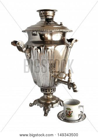Vintage metal tea samovar with a cup isolated on white background