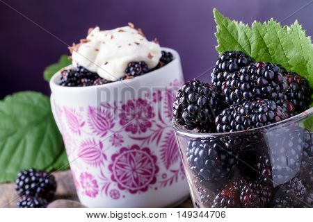 Cup Of Fresh Natural Blackberries With Leafs