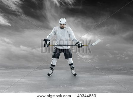 Ice hockey player stay on the ice and wait on sport actions.