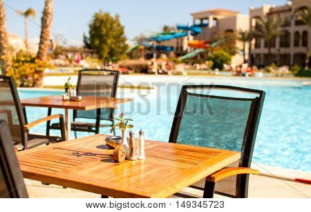 wooden table top pool chairs with blurred background - can be used for mounting