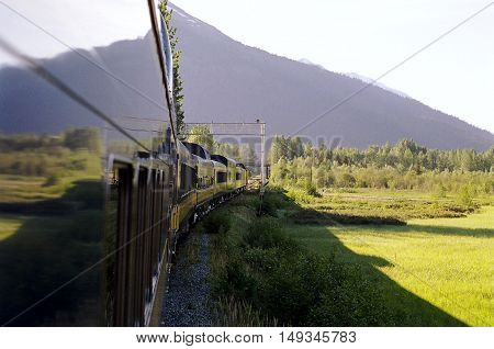 Train reflected as it rounded a curve in the Alaskan wilderness. . . heading to amazing Denali.