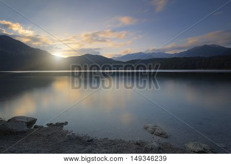 Sunset at lake Eibsee in Bavaria, Germany. Long time exposure shot.