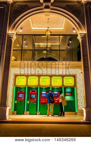 Phuket Thailand - Jan 29 2016 : Front of Kasikorn bank shown ATM set in the night time with Sino-portuguese architectural style. It is well-known destionation for tourist as it is very beautiful.