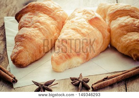 Croissants on plate on wooden table for breakfast