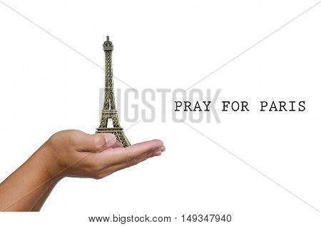 Open hand with a model the Eiffel Tower and have word pray for paris.