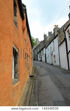 A view along a narrow residential street in the medieval village of Culross