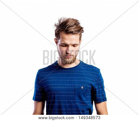 Hipster man in striped blue t-shirt, studio shot on white background, isolated