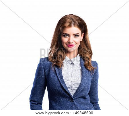 Young beautiful woman in white dotted blouse and blue jacket, studio shot on white background, isolated
