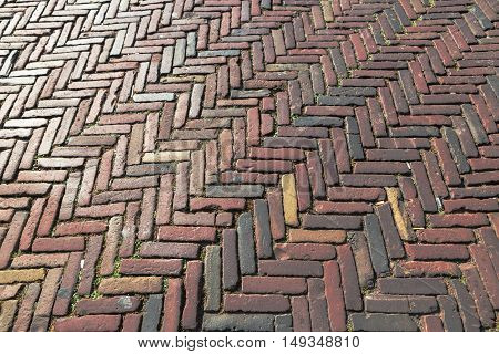 Old inlaid brick paving, Old paving made of red bricks. Background concept. Architecture concept.