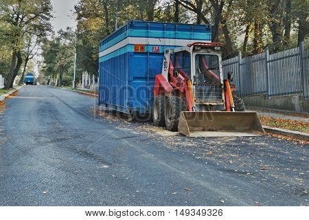 2016/09/24 - Chomutov Czech republic - little red excavator parked on the street Politickych veznu in Chomutov city during a repair of sewerage