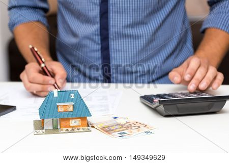 property management concept, man calculating house expenses